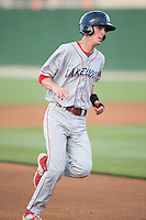 Carlos Tocci (15) of the Lakewood BlueClaws rounds third base during the game against the Kannapolis Intimidators at CMC-Northeast Stadium on May 16, 2015 in Kannapolis, North Carolina.  The BlueClaws defeated the Intimidators 9-7.  (Brian Westerholt/Four Seam Images)