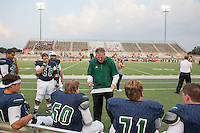 Coaches work with players on the sidelines during a high school football game between McNeil High School and Harker Heights High School at Kelly Reeves Stadium in Round Rock on Thursday, September 1, 2016.