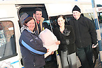 Garda Anita O'Shea, Liam Kelly, Barbara Tiernan and Brian Reynolds load up the vans with donations for Flood Victims...Photo NEWSFILE/Jenny Matthews.(Photo credit should read Jenny Matthews/NEWSFILE)....This Picture has been sent you under the condtions enclosed by:.Newsfile Ltd..The Studio,.Millmount Abbey,.Drogheda,.Co Meath..Ireland..Tel: +353(0)41-9871240.Fax: +353(0)41-9871260.GSM: +353(0)86-2500958.email: pictures@newsfile.ie.www.newsfile.ie.FTP: 193.120.102.198.
