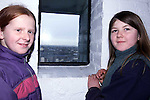 Victoria Hand and Angela Cassidy looking out of the window in Millmount.Pic Fran Caffrey Newsfile