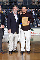 SAN ANTONIO , TX - JANUARY 23, 2010: The St. Mary's University Rattler's Men's Golf team is recognized for their Academic National Championship during halftime of the Dallas Baptist University Patriots vs. the St. Mary's University Rattlers Men's Basketball game at the Bill Greehey Arena. (Photo by Jeff Huehn)