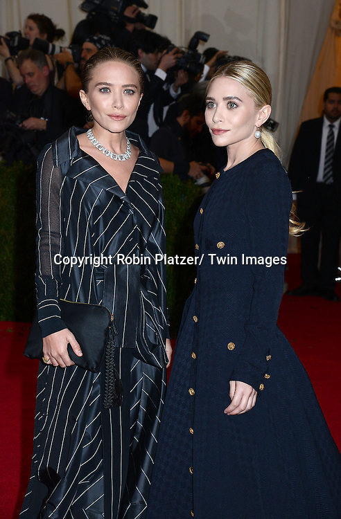 Ashley and Mary Kate Olsen attend the Costume Institute Benefit on May 5, 2014 at the Metropolitan Museum of Art in New York City, NY, USA. The gala celebrated the opening of Charles James: Beyond Fashion and the new Anna Wintour Costume Center.