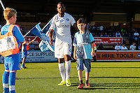 Players enter the pitch with mascots ahead of the Friendly match between Wycombe Wanderers and Brentford at Adams Park, High Wycombe, England on 19 July 2016. Photo by David Horn / PRiME Media Images.