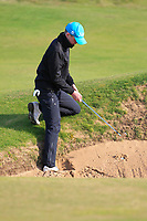 Keaton Morrison (Greenacres) finding a stance for this tricky shot out of a bunker on the 10th during Round 3 of the Ulster Boys Championship at Royal Portrush Golf Club, Valley Links, Portrush, Co. Antrim on Thursday 1st Nov 2018.<br /> Picture:  Thos Caffrey / www.golffile.ie<br /> <br /> All photo usage must carry mandatory copyright credit (&copy; Golffile | Thos Caffrey)