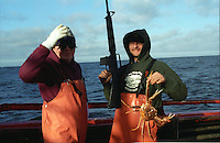 Alex Vasilchecko and Frank R. Speigel of the Arctic Dawn fishing for opilio crab in the Bering Sea in January 1994.(© Karen Ducey)