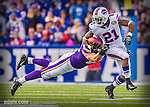 19 October 2014: Buffalo Bills cornerback Leodis McKelvin is pursued by Minnesota Vikings tight end Rhett Ellison on a kickoff during the third quarter at Ralph Wilson Stadium in Orchard Park, NY. The Bills defeated the Vikings 17-16 in a dramatic, last minute, comeback touchdown drive. Mandatory Credit: Ed Wolfstein Photo Original image was made as a RAW (NEF) file using a Nikon D4 DSLR camera.
