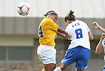 20 September 2009: Duke's Cody Newman (8) heads a shot past LSU's Nikki Bush (left). The Duke University Blue Devils played the Louisiana State University Tigers to a 2-2 tie after overtime at Koskinen Stadium in Durham, North Carolina in an NCAA Division I Women's college soccer game.