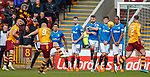 31.3.2018: Motherwell v Rangers: <br /> Rangers wall stands firm as Curtis Main blasts the ball