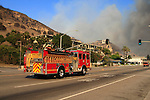 Fire in Malibu, California October 21, 2007. Firefighters watch the brush below. The wildfire fanned by powerful winds burned out of control on Sunday in the celebrity seaside enclave of  Malibu, forcing hundreds of people to flee and destroying a handful of multimillion-dollar homes. Photo by Nina Prommer/Milestone Photo.