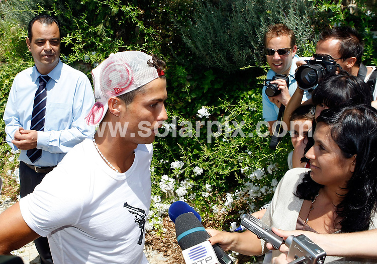 **ALL ROUND PICTURES FROM SOLARPIX.COM**.**WORLDWIDE SYNDICATION RIGHTS EXCEPT FOR PORTUGAL AND SPAIN** **NO PUBLICATION IN PORTUGAL OR SPAIN**.Cristiano Ronaldo outside his Holiday Villa on the Algarve in Portugal. Cristiano his on holiday  with his family having a short break before he signs for Real Madrid FC on the 6 the of July...This pic:Cristiano Ronaldo..JOB REF:9334      NPP     DATE:22.06.09.**MUST CREDIT SOLARPIX.COM OR DOUBLE FEE WILL BE CHARGED**.***ONLINE USAGE FEE GBP 50.00 PER PICTURE - NOTIFICATION OF USAGE TO PHOTO @ SOLARPIX.COM**.**CALL SOLARPIX : +34 952 811 768 or LOW RATE FROM UK 0844 617 7637**