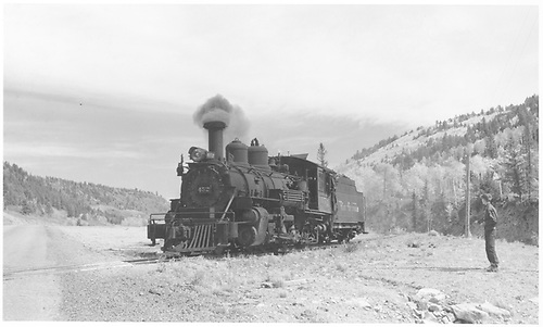 Pilot end fireman side view of D&amp;RGW K-27 #452 idling at a road crossing.<br /> RGS  Peake to Wade, CO  Taken by Richardson, Robert W. - 9/26/1951