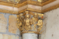 Carved gilded capital with decoration of armour and weapons from the Porte Doree, built 16th century under Francois I and the main entrance until the 17th century, at the end of the líAllee de Maintenon, an avenue of lime trees, Chateau de Fontainebleau, France. The gate leads to the King's private chapel. The Palace of Fontainebleau is one of the largest French royal palaces and was begun in the early 16th century for Francois I. It was listed as a UNESCO World Heritage Site in 1981. Picture by Manuel Cohen