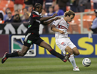 9 April 2005.   Chicago's Justin Mapp (21) is tackled by David Stokes (2) of DC United at RFK Stadium in Washington, DC.