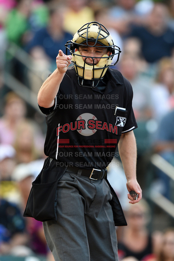 Umpire Brad Myers makes a call during a game between the Indianapolis Indians and Rochester Red Wings on July 26, 2014 at Frontier Field in Rochester, New  York.  Rochester defeated Indianapolis 1-0.  (Mike Janes/Four Seam Images)