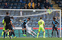 Joe Jacobson of Wycombe Wanderers heads clear of goal during the Sky Bet League 2 match between Wycombe Wanderers and Hartlepool United at Adams Park, High Wycombe, England on 5 September 2015. Photo by Andy Rowland.