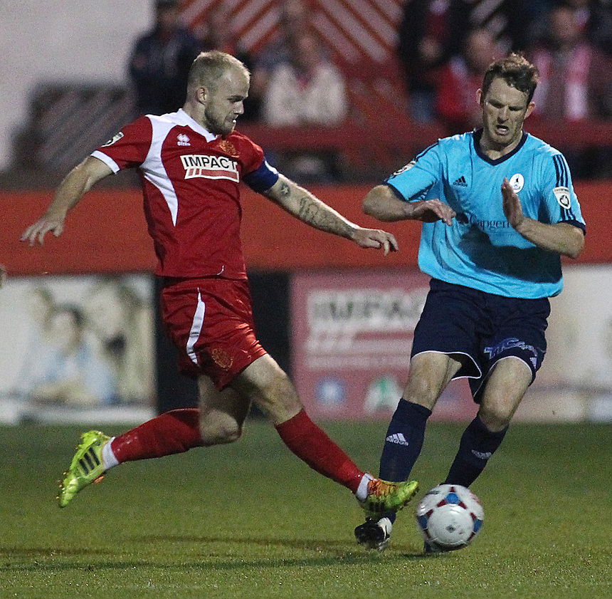 Alfreton Town's Bradley Wood vies for possession with AFC Telford United's Andy Todd<br /> <br /> Photo by Rich Linley/CameraSport<br /> <br /> Football - English Football Vanarama Conference Premier League - Alfreton Town v AFC Telford United - Tuesday 16th September 2014 - Impact Arena - Alfreton<br /> <br /> &copy; CameraSport - 43 Linden Ave. Countesthorpe. Leicester. England. LE8 5PG - Tel: +44 (0) 116 277 4147 - admin@camerasport.com - www.camerasport.com