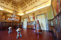 Third Room of The Library. Queen Mary Caroline commissioned  German painter Freidrich Heinrich Fuger to decorate the Third Library Room. The paintings on the wall represent classical themes of: The Parnassus with Apollo and the Three Graces, The Envy and the Richness, The School of Athens, The protection of The Arts. The two globes represent the planisphere and the astral map and were donated to Ferdinand IV of Bourbon by King of France Louis XVI, his brother-in-law. The Kings of Naples Royal Palace of Caserta, Italy. A UNESCO World Heritage Site