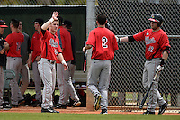 Illinois State Redbirds Ryan Koziol (2) greeted by Sean Beesley (29) and Blake Molitor (42) after scoring a run during a game against the Georgetown Hoyas on March 7, 2015 at North Charlotte Regional Park in Port Charlotte, Florida.  Illinois State defeated Georgetown 2-1.  (Mike Janes/Four Seam Images)