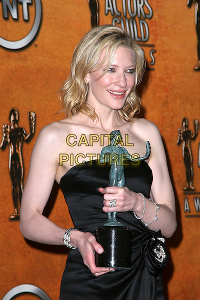 CATE BLANCHETT.11th Annual Screen Actors Guild Awards (SAG) held at the Shrine Auditorium. Los Angeles, California.Photo Credit: Jacqui Wong/AdMedia.February 5th, 2005.half length, award, trophy, strapless, smokey eyes, eyeliner.www.capitalpictures.com.sales@capitalpictures.com.© Capital Pictures.
