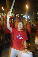 Korean national team supporters celebrate in the Itaewon neighborhood of Seoul, South Korea on June 18th, 2002 after South Korea defeated Italy in a World Cup round of 16 match 2-1.
