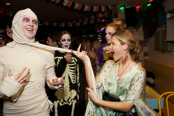 Amber Atherton strips an Egyptian mummy at the Myflashtrash Halloween Party  at Barrio, Soho, London