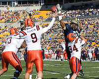 Pitt linebacker Dorin Dickerson attempts to block a pass thrown by Syracuse quarterback Andrew Robinson. The Pitt Panthers defeated the Syracuse Orange  20-17 on November 03, 2007 at Heinz Field, Pittsburgh, Pennsylvania.