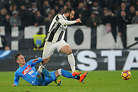 Calcio, semifinale di andata di Tim Cup: Juventus vs Napoli. Torino, Juventus Stadium, 28 febbraio 2017.<br /> Juventus&rsquo; Gonzalo Higuain, right, is tackled by Napoli's Arkadiusz Milik during the Italian Cup semifinal first leg football match between Juventus and Napoli at Turin's Juventus stadium, 28 February 2017.<br /> UPDATE IMAGES PRESS/Manuela Viganti