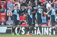Matt Bloomfield (2nd left) of Wycombe Wanderers celebrates scoring to make it 1-0 during the Sky Bet League 2 match between Leyton Orient and Wycombe Wanderers at the Matchroom Stadium, London, England on 19 September 2015. Photo by Andy Rowland.
