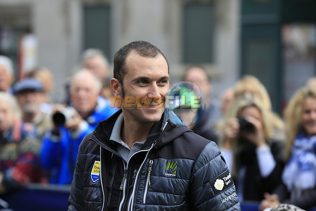 Ivan Basso (ITA) Tinkoff-Saxo, recently recovered from testicular cancer surgery, chats with riders and fans at sign on for the start of the last classic of the season Il Lombardia 2015 running 245km from Bergamo to Como, Italy. 4th October 2015.<br /> Picture: Eoin Clarke | Newsfile