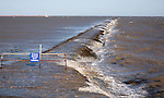 High seas forcing waves over the harbour mouth breakwater at Harwich, Essex, England