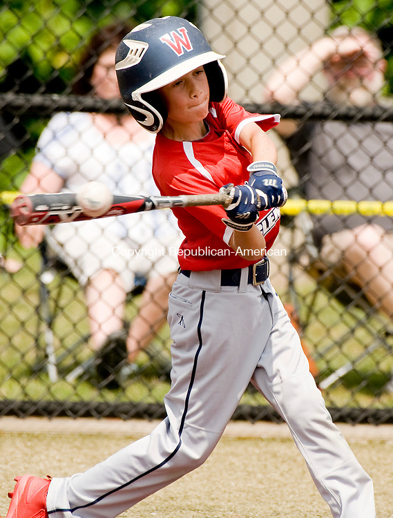 WATERBURY, CT-0712217JS06--Wolcott's Jay Derosa (6) rips a double during their Roberto Clemente Tournament game against the BC Cyclones Saturday at Municipal Stadium in Waterbury. <br /> Jim Shannon Republican-American