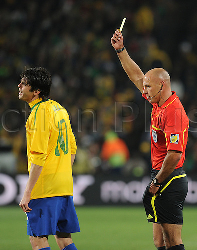 Kaka of Brazil speaks with referee Howard Webb and gets a yellow card during the 2010 FIFA World Cup soccer match between Brazil and Chile at Ellis Park Stadium on June 28, 2010 in Johannesburg, South Africa.