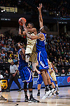 Madison Jones (1) of the Wake Forest Demon Deacons drives to the basket between two UNC Asheville Bulldogs defenders during first half action at the LJVM Coliseum on November 14, 2014 in Winston-Salem, North Carolina.  The Demon Deacons defeated the Bulldogs 80-69  (Brian Westerholt/Sports On Film)