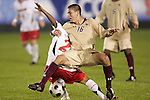 14 November 2008: Boston College's Alejandro Bedoya (16) and Maryland's A.J. Delagarza (behind). The University of Maryland defeated Boston College 1-0 at WakeMed Stadium at WakeMed Soccer Park in Cary, NC in a men's ACC tournament semifinal game.