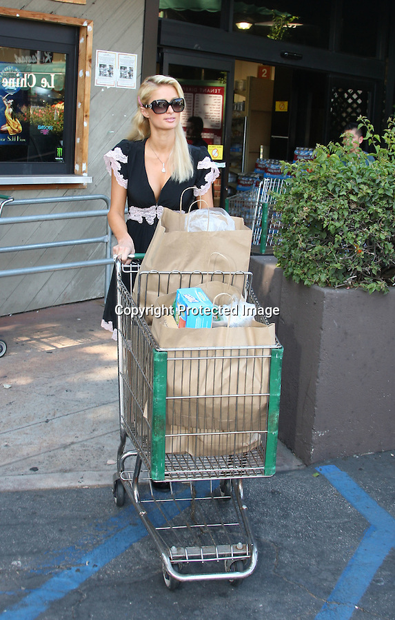 9-19-09...Paris Hilton went shopping at Kate Somerville on Melrose Place in west hollywood wearing some big black high heels a black dress with pink lace. Paris also had on a pink diamond watch & ring .Then Paris drove to the Beverly Glen grocery store shopping for fruit beer & noodles checked out some greeting cards. Paris's aunt Kyle Richards dropped her cell phone outside & paris picked it up for her. Then paris talked with fans for about 5 minutes.  Paris was also checking out her cleavage & wearing Chloe sunglases  Paris paid with her black card. ....Abilityfilms@yahoo.com.805-427-3519.www.AbilityFilms.com