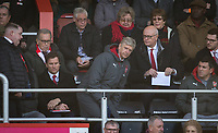 Arsenal Manager Arsene Wenger takes his seat as club secretary David Miles holds onto an envolope during the Premier League match between Bournemouth and Arsenal at the Goldsands Stadium, Bournemouth, England on 14 January 2018. Photo by Andy Rowland.
