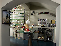 The kitchen is built into the vaulted basement area of the house complete with display cabinets of stuffed birds