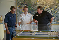 NWA Democrat-Gazette/BEN GOFF @NWABENGOFF<br /> Bill Hagenburger (from left), plant engineer with Beaver Water District, Brad Hammond and Lane Crider with McGoodwin Williams & Yates, an engineering consultant firm in Fayetteville, look at a model of the Beaver Water District facility Monday, May 8, 2017, during a press conference to kick off National Drinking Water Week at the Beaver Water District offices and Water Education Center in Lowell. The event highlighted a new public education camaign and recognized the hard work of the staff at Beaver Water District and the four cities, Bentonville, Rogers, Springdale and Fayetteville, that buy water from the district.