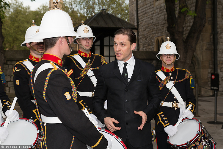 British actor, Tom Hardy chats to Royal Marines in the Tower of London on 30th April 2014. The Royal Marines Corps of Drums are attempting to break the World record for the longest continuous drum roll as part of a year of celebrations to mark the 350th anniversary of the Royal Marines and raising money for the Royal Marines Charitable Trust Fund.  The current record stands at 28 hours, 19 minutes and 3 seconds and they hope to extend this to 64 hours.