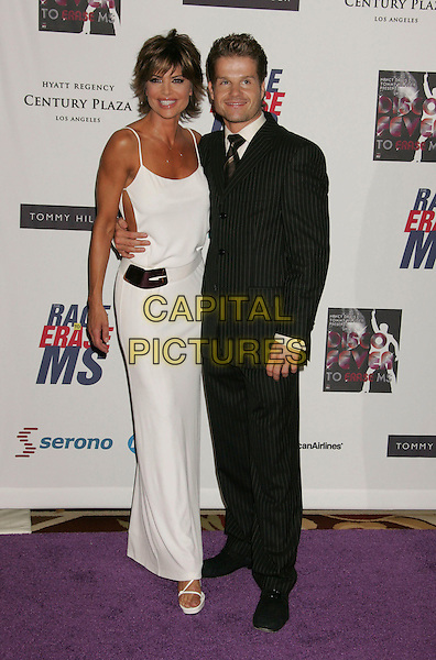 LISA RINNA & HARRY HAMLIN.Arrivals - 13th Annual Race to Erase MS held at the Hyatt Regency Century Plaza Hotel, Century City, California, USA, 12 May 2006..full length white dress couple.Ref: ADM/RE.www.capitalpictures.com.sales@capitalpictures.com.©Russ Elliot/AdMedia/Capital Pictures.
