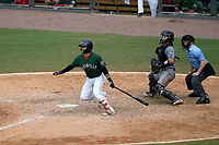 Right fielder Victor Acosta (11) of the Greenville Drive gets a hit in the ninth inning of a game against the Asheville Tourists, 7-6, on Sunday, June 3, 2018, at Fluor Field at the West End in Greenville, South Carolina. Greenville won, 7-6. (Tom Priddy/Four Seam Images)