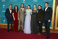 "HOLLYWOOD, CA - FEBRUARY 13: Matthew B. Roberts, Maril Davis, Richard Rankin, Sophie Skelton, Caitriona Balfe, Ronald D. Moore and Sam Heughan, at the Premiere Of Starz's ""Outlander"" Season 5 at HHollywood Palladium in Hollywood California on February 13, 2020. Credit: Faye Sadou/MediaPunch"