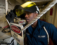 110301-N-DR144-029 ARABIAN SEA (March 1, 2011) Electrician's Mate Fireman Alex Kline, assigned to Engineering Department's Electrical Division, asks another Electrician's Mate for a tool while attending to a lighting trouble-call aboard the Nimitz-class aircraft carrier USS Carl Vinson (CVN 70). The Carl Vinson Carrier Strike Group is deployed supporting maritime security operations and theater security cooperation efforts in the U.S. 5th Fleet area of responsibility. (U.S. Navy photo by Mass Communication Specialist 2nd Class James R. Evans / RELEASED)
