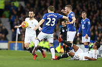 Leon Britton competes with Seamus Coleman during the Barclays Premier League match between Everton and Swansea City played at Goodison Park, Liverpool