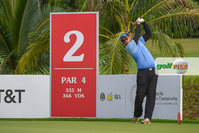 Vanseiha SENG (CAM) watches his tee shot on 2 during Rd 1 of the Asia-Pacific Amateur Championship, Sentosa Golf Club, Singapore. 10/4/2018.<br /> Picture: Golffile | Ken Murray<br /> <br /> <br /> All photo usage must carry mandatory copyright credit (© Golffile | Ken Murray)