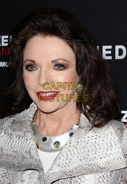 "JOAN COLLINS .""The Kennedys"" World Premiere Held At The AMPAS Samuel Goldwyn Theater, Beverly Hills, California, USA, .28th March 2011..portrait headshot red lipstick make-up beauty necklace eyeliner white snakeskin print animal snake jacket .CAP/ADM/KB.©Kevan Brooks/AdMedia/Capital Pictures."