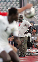 Ghana's Coach Sellas Tetteh  watches his team battle Hungary during the FIFA Under 20 World Cup Semi-final match at the Cairo International Stadium in Cairo, Egypt, on October 13, 2009. Costa Rica won the match 1-2 in overtime play. Ghana won the match 3-2.