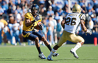 Marvin Jones (1) makes the run for the touchdown against Andrew Abott (26). The California Golden Bears defeated the UCLA Bruins 35-7 at Memorial Stadium in Berkeley, California on October 9th, 2010.