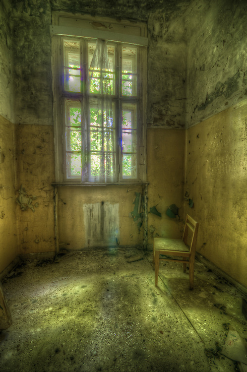 AN old lunatic asylum outside of Berlin with decaying room interior