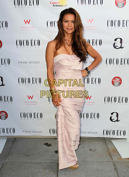 Nia Peeples.Coco Eco Green Emmy Suite Held at At W Hollywood Hotel, Hollywood, California, USA..September 19th, 2012.full length pink strapless dress layered layers hand on hip.CAP/ADM/FS.©Faye Sadou/AdMedia/Capital Pictures.